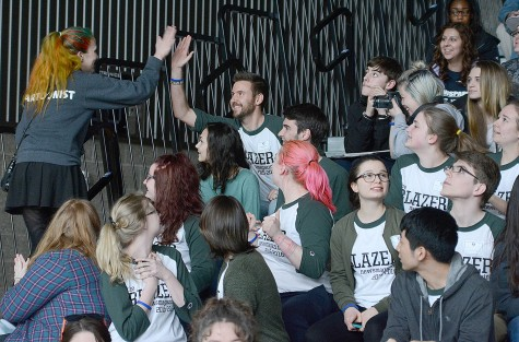 A winning student gets a high five.