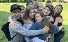 Group of students hug at camp 2019.
