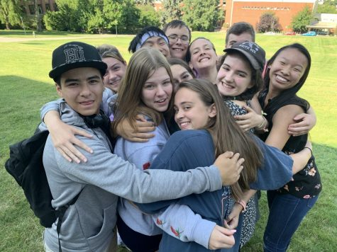 Group of students hug at camp 2019.